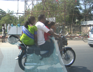 Family of 4 on a 2 wheeler