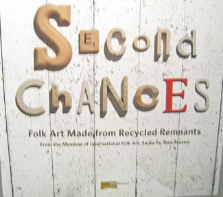 The poster of Second Chances, recycling cans, wires, tires, to make crafts such as cars, radios, lunch boxes