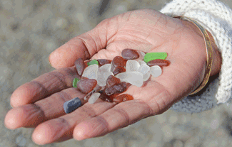 olding some of the glass from the beach in the palm of my hand